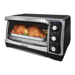 "Applica - BD 6 Slice Convec Toaster Oven - Black & Decker Convection Countertop Oven with Black/ Stainless Steel finish has a 6-slice capacity with controls like convection bake  broil and reheat!  Extra-Deep Interior fits up to 6 Slices or a 12"" Pizza; 60-Minute Timer; Convection Cooking -saves time and energy cooking; Perfect Broil System  Dual-Position Rack Slots for placing the rack closer to or farther from the broiler; Included Broil Rack & Bake Pan lets you cook a variety of meals; Removable Crumb Tray for easy cleaning.  This item cannot be shipped to APO/FPO addresses. Please accept our apologies."