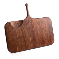 De JONG & Co. - Serving Board No.5 - Hand-shaped black walnut. Leather hanging loop. Hand-carved cutout. Food safe. Fully seasoned with walnut oil and wax finish. Products are made to order which can result in longer lead times.