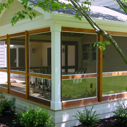 Retro-fit Porch Enclosure - Budding Branch - Glenelg MD installed this modular cedar porch unto an existing deck with columns.