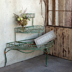Potted Plant Etagere - Three levels of semi-circular display space on sinuous legs provide plenty of show-off shelving for prized plants. The bonus? The rustic, grass green metal étagère sits flush against the wall.