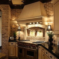 For the Home / Kitchen-exposed brick, light cabinets,dark floors!