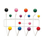 Hang- It-All Coat Rack - Add a bright splash of pop color and wall art to your front hall, foyer, or any room in your house or office. Made of white metal and multi-color wood balls, this pop color hanging rack holds jackets, scarves, skates, knapsacks, jump rope, etc. More than just a conversation piece, the Hang-It-All holds anything that slips over its colorful hooks.