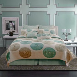 Nostalgia Home - Nostalgia Home Madison Quilt - Decorate your bedroom with refreshing style courtesy of the Madison quilt. A modern color scheme in aqua and taupe is rendered in round, swirled appliqués that give this quilt a trendy look. Frayed edges complement the design with flair.