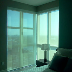 """Blinds, shades and shutters - Corner butt windows can be tricky.  These shades are the perfect solution in any situation.  5% sun filtration sheerweave shades with a 4"""" square fascia to hide rollers and mechanisms."""