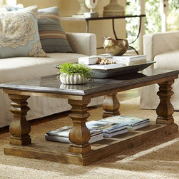 SUTTON COFFEE TABLE - The slate top of this coffee table contrasts beautifully with the weathered wood base and thick columns that support it. An open shelf below is an extra perk for a light cache of magazines and books.