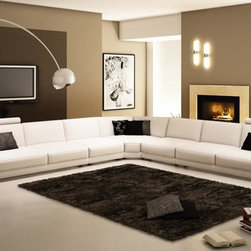 Caliaitalia 954 -modern sectonal sofa - This contemporary sectional sofa will add instant appeal to your living space. Its soft curvy appearance has all the features to make it the stylish and favored seat of the house. It comes upholstered in genuine high quality Italian Leather where your body touch the seat.