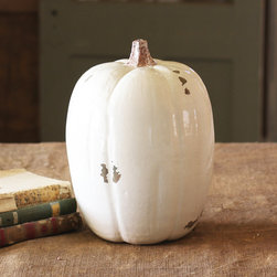 Glossy Ceramic Pumpkin - Fall splendor takes a turn for the sophisticated with this snowy-white ceramic pumpkin. With a touch of distress in the glossy glazed finish, it handsomely blends modern sleekness with rustic charm.
