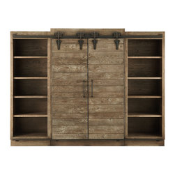 """Baumann Media Center - Childhood memories of summers spent on a farm in central Ohio became our inspiration for the sliding barn doors of our Baumann Media Center. To recreate the authentic look and function of traditional barn doors, artisans hand-plane solid oak that is grown and harvested in America, into sections framed by solid angle iron. Each section is hand-finished with an antique rust patina. Even the hardware has been replicated. Cast iron is hand-forged into hinges and corner plates, and the castings for the wheels and tracks are inscribed with the words """"Ashland County,"""" reminiscent of original barn doors. Slide the rustic doors toward the center and Baumann is transformed into a showcase for books and other treasured items. Slide them apart to reveal a media entertainment center with room enough for a large TV. Four oversized drawers and shelving provide additional storage."""