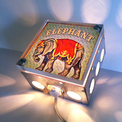 Circus Elephant Nursery Night Light by The Rekindled Page - Night lights are a fun part of any kid's room, and they're so important when keeping kids happy at bedtime. Help them have big top dreams with this sweet elephant by their sides.