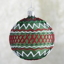 Green Ric-Rac Ball Ornament - A stylized, glittering take on ric-rac ribbon combines zigzags and cross-hatching in our artisanal modern glass ornament group. Each is handcrafted, hand-painted and decorated by German craftsmen in a classic holiday palette of green, white and red.