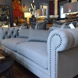 Neutral Is In: What's Hot in Custom Upholstery - The elegance of tufting with nailheads contrasts with the subtle gray of this settee to give your room a well-dressed look.