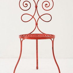 Versha Red Chair - These whimsical chairs would set the tone for a garden tea party. I like the idea of mixing and matching them in different colors.