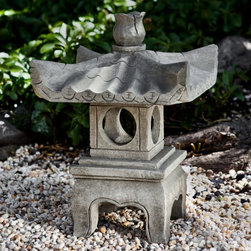 Campania International - Campania International Antique Pagoda Garden Statue - OR-144 - NATURAL - Shop for Statues and Sculptures from Hayneedle.com! About Campania InternationalEstablished in 1984 Campania International's reputation has been built on quality original products and service. Originally selling terra cotta planters Campania soon began to research and develop the design and manufacture of cast stone garden planters and ornaments. Campania is also an importer and wholesaler of garden products including polyethylene terra cotta glazed pottery cast iron and fiberglass planters as well as classic garden structures fountains and cast resin statuary.Campania Cast Stone: The ProcessThe creation of Campania's cast stone pieces begins and ends by hand. From the creation of an original design making of a mold pouring the cast stone application of the patina to the final packing of an order the process is both technical and artistic. As many as 30 pairs of hands are involved in the creation of each Campania piece in a labor intensive 15 step process.The process begins either with the creation of an original copyrighted design by Campania's artisans or an antique original. Antique originals will often require some restoration work which is also done in-house by expert craftsmen. Campania's mold making department will then begin a multi-step process to create a production mold which will properly replicate the detail and texture of the original piece. Depending on its size and complexity a mold can take as long as three months to complete. Campania creates in excess of 700 molds per year.After a mold is completed it is moved to the production area where a team individually hand pours the liquid cast stone mixture into the mold and employs special techniques to remove air bubbles. Campania carefully monitors the PSI of every piece. PSI (pounds per square inch) measures the strength of every piece to ensure durability. The PSI of Campania pieces is currently engineere