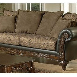 "Chelsea Home Serta Ronalynn Sofa - San Marino Chocolate - Host family gatherings during the holidays or Sunday mornings spent with friends drinking coffee in style and luxury atop this Chelsea Home Serta Ronalynn Sofa - San Marino Chocolate. Hints of old Victorian style dominate the design of this traditionally-styled sofa, including an elegantly carved wooden frame featuring ornate trim and rolled armrests that stand out against gorgeous dark brown leather upholstery. The sofa's frame was constructed from solid hardwood and features sturdy legs that add durability over years of usage. The two seat cushions are also wrapped in elegant upholstery and were constructed with 1.8 density foam and no-sag springs that offer an optimal mix of comfort and support – meaning you're just as apt to stay attentive while conversing with friends as you might be drifting into a well-deserved afternoon nap. At nearly eight feet wide, the sofa comfortably seats three. Rounding out the set are six pillows of varying sizes that serve as the back cushions as well as ""utility"" pillows that can be used for napping or as extra arm support.About Chelsea Home FurnitureProviding home elegance in upholstery products such as recliners, stationary upholstery, leather, and accent furniture including chairs, chaises, and benches is the most important part of Chelsea Home Furniture's operations. Bringing high quality, classic and traditional designs that remain fresh for generations to customers' homes is no burden, but a love for hospitality and home beauty. The majority of Chelsea Home Furniture's products are made in the USA, while all are sought after throughout the industry and will remain a staple in home furnishings."