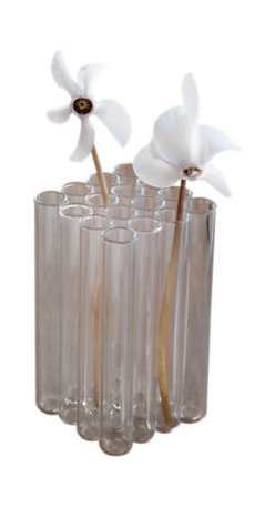 Design Ideas - Field Vase - This little bud vase is covered in a soft, dark flocking over handmade glass that begs to be touched. We achieve the rich luster of the felt-like covering by a double coating using slightly different tones of the material. Completely waterproof, this little vase is ideal for a desk, sophisticated bathroom or a dinner table focused on understated elegance. This is a conversation piece as well as a gift.