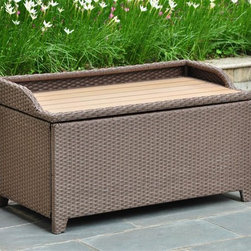 International Caravan - Outdoor Storage Bench in Antique Brown Finish - Seats one person comfortably. Water resistant. Durable rust free frame. Easy to open for extra storage. Made from wicker resin and aluminum frame. Assembly required. 40 in. W x 20 in. D x 20 in. H (40 lbs.)Perfect for storing towels or garden accessories. This is a perfect outdoor decorative for any outdoor setting.