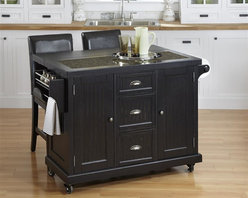 "HomeStyles - Distressed Black Kitchen Cart and Two Stools - Give your home a cozy, inviting atmosphere with the Nantucket Kitchen Cart and Two Stools. It's sanded worn edges and distressed black finish provides the casual elegance that's great for any home decor style. The Nantucket Kitchen Cart and Two Stools is constructed of hardwood solids and engineered wood. Finishing process includes paint specking on the sanded and distressed finish providing a weathered look. Features include ���_ inch speckled multi-color black granite inset, two cabinet doors each containing an adjustable shelf, three storage shelves, built-in spice rack and towel bar, paper towel holder, and industrial size casters (two locking). Bar Stools feature black vinyl seat and Back, and a metal foot rest to protect the front rail. Seat height 24"". Set includes kitchen cart and two stools. Kitchen Cart Size: 53.5 in. W x 20.75 in. D x 36.25 in. H x . Stool Size: 18 in. W x 21 in. D x 40 in. H"
