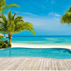 Pool Wall Mural - This tropical mural features a resplendent infinity pool twinkling in the sun with the aquamarine ocean stretching out beyond.