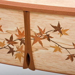 Japenese Maple Leaf Cabinet - The doors have handles carved from Mahogany as an accent to the overall design.