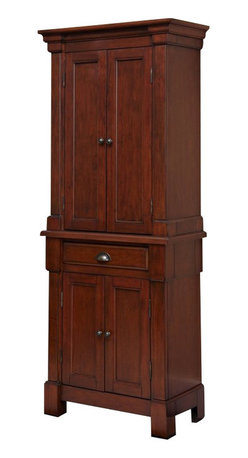 Home Styles - Home Styles Aspen Pantry in Rustic Cherry Finish - Home Styles - Pantry - 552069 - Create ambiance with a perfect balance of warmth and style with the Aspen Pantry by Home Styles. Mahogany solids, Engineered Wood, and cherry veneers are warmed with a Rustic Cherry finish. The Pantry encapsulates distinguished Americana style with bold recessed picture frame moldings, rich carved detailed solid wood pilasters, and antiqued brass hardware. Incorporate function and storage with attractive design. Bounteous storage is provided with one storage drawer, and two cabinet doors each containing two adjustable shelves. Spacious enough to accommodate large cereal box and can double as a wardrobe.