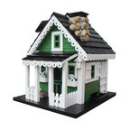 """Home Bazaar Inc. - Greenacres Feeder - Green/White/Black - Features: twin side dormers; bay windows; bull's eye, roof line scrollwork; picket fence front porch; two scalloped flower boxes with blue flowers; white trellis; stone chimney with chimney cap; matching birdhouse decoration; flower pot; storm shutters; black, pine shingled roof; lift-out, magnetic roof opening; and a pyramid-shaped center piece in the middle of the floor to spread seed to all four sides. Comes with a mounting plate that allows easy placement on a wooden 4"""" X 4"""" and an ingenious steel cable to hang the feeder."""