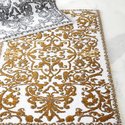"Abyss & Habidecor - Perse Bath Rug - GOLD (BATH RUG) - Abyss & HabidecorPerse Bath RugDetailsMade of combed cotton and acrylic with Lurex metallic fibers.Platinum or Gold scroll pattern on white ground.27"" x 49"".Machine wash.Made in Portugal."