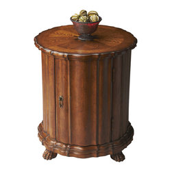 Butler Furniture - Drum Table - Selected solid woods, wood products and choice veneers. Hand carved details. Maple, walnut and cherry veneers inlay top with oak veneer border. Door with antique brass finished hardware.