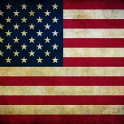 LimitLess Walls - American Flag Mural - Be patriotic and the let the flag fly on your wall. Our removable canvas wallpaper has no paste and leaves no mess. Apply yourself again and again.