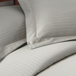 Colonial Home Textiles - Silver Stripe 800-Thread Count Duvet Set - Perfect for discerning tastes, this lovely set will turn any mattress into a masterpiece within moments. There's no guesswork needed to create a luxuriously soft and stylish sleeping area—the matching shams coordinate perfectly already.   Includes duvet cover and two shams 55% cotton / 45% polyester 800-thread count Machine wash; tumble dry Imported