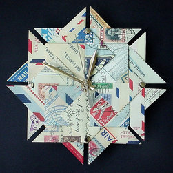 Airmail Origami Clock by Gifted Papers - A clock made out of paper? Why not! This unique origami design would look so cute above a writing desk or souvenir collection.