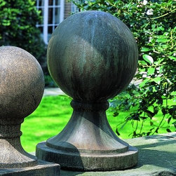 Campania International Large Round Sphere Cast Stone Garden Statue Base - About Campania InternationalEstablished in 1984, Campania International's reputation has been built on quality original products and service. Originally selling terra cotta planters, Campania soon began to research and develop the design and manufacture of cast stone garden planters and ornaments. Campania is also an importer and wholesaler of garden products, including polyethylene, terra cotta, glazed pottery, cast iron, and fiberglass planters as well as classic garden structures, fountains, and cast resin statuary.Campania Cast Stone: The ProcessThe creation of Campania's cast stone pieces begins and ends by hand. From the creation of an original design, making of a mold, pouring the cast stone, application of the patina to the final packing of an order, the process is both technical and artistic. As many as 30 pairs of hands are involved in the creation of each Campania piece in a labor intensive 15 step process.The process begins either with the creation of an original copyrighted design by Campania's artisans or an antique original. Antique originals will often require some restoration work, which is also done in-house by expert craftsmen. Campania's mold making department will then begin a multi-step process to create a production mold which will properly replicate the detail and texture of the original piece. Depending on its size and complexity, a mold can take as long as three months to complete. Campania creates in excess of 700 molds per year.After a mold is completed, it is moved to the production area where a team individually hand pours the liquid cast stone mixture into the mold and employs special techniques to remove air bubbles. Campania carefully monitors the PSI of every piece. PSI (pounds per square inch) measures the strength of every piece to ensure durability. The PSI of Campania pieces is currently engineered at approximately 7500 for optimum strength. Each piece is air-dried and then de-molded by hand. After an internal quality check, pieces are sent to a finishing department where seams are ground and any air holes caused by the pouring process are filled and smoothed. Pieces are then placed on a pallet for stocking in the warehouse.All Campania pieces are produced and stocked in natural cast stone. When a customer's order is placed, pieces are pulled and unless a piece is requested in natural cast stone, it is finished in a unique patinas. All patinas are applied by hand in a multi-step process; some patinas require three separate color applications. A finisher's skill in applying the patina and wiping away any excess to highlight detail requires not only technical skill, but also true artistic sensibility. Every Campania piece becomes a unique and original work of garden art as a result.After the patina is dry, the piece is then quality inspected. All pieces of a customer's order are batched and checked for completeness. A two-person packing team will then pack the order by hand into gaylord boxes on pallets. The packing material used is excelsior, a natural wood product that has no chemical additives and may be recycled as display material, repacking customer orders, mulch,or even bedding for animals. This exhaustive process ensures that Campania will remain a popular and beloved choice when it comes to garden decor.Please note this product does not ship to Pennsylvania.