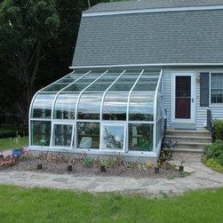 Curved Eave Solarium / Greenhouse -
