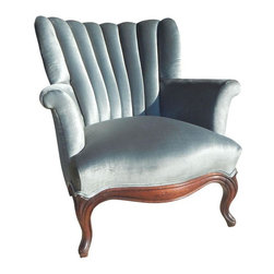 Pre-owned French Blue Velvet Armchair - A french blue velvet armchair with a simple and elegant design!  The wood has some wear to it and there are a few scratches and imperfections in the newly upholstered fabric.  The chair is solid and sturdy and in good vintage condition with many years left.  Overall a gorgeous chair that will highlight any room it is placed in.