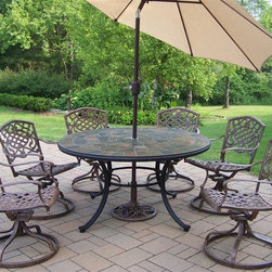 Oakland Living - Stone Art 9-Pc Aluminum Outdoor Dining Set - Includes table, six arm chairs, tilting umbrella and umbrella stand. Fade, chip and crack resistant. Solid and sturdy yet trendy designs. Brass hardware. Warranty: One year limited. Made from natural stone and rust free cast aluminum. Hardened powder coat finish in antique bronze. Minimal assembly required. Table: 54 in. Dia. x 29 in. H. Swivel chair: 23 in. W x 17.5 in. D x 38 in. H (66 lbs.). Umbrella: 108 in. L x 108 in. W x 100 in. H (45 lbs.)Our stone art dining sets will be a beautiful addition to your patio, balcony or outdoor entertainment area. Stone art dining sets are perfect for any small space or to accent a larger space. The Oakland Stone Art Collection combines natural stone and modern designs giving you a rich addition to any outdoor setting.