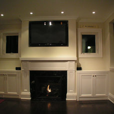 Traditional Fireplaces by Jencia Custom Cabinets & Mantels Inc.