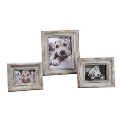 Uttermost Niho Ivory Photo Frames S/3 - Heavily distressed aged ivory with natural wood undertones. Heavily distressed aged ivory finish with natural wood undertones. Holds photo sizes:4x6, 5x7 & 8x10. Sizes:sm-8x10, med-9x11, lg-12x14