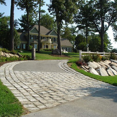 Traditional Landscape by UBLA Site Planners & Landscape Architects