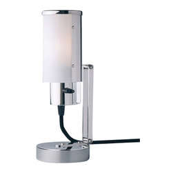 """Tecnolumen - Tecnolumen Wagenfeld WNL 30 Multi Purpose Lamp - The Wagenfeld WNL 30 Multi Purpose Lamp is designed by Wilhelm Wagenfeld and made by Tecnolumen. Wagenfeld WNL 30 Multi Purpose Lamp is a perfect showcase for how elegant and sophisticated functional design can be. It was originally described as a """"bedside table lamp to be used also as wall sconce"""" in the Bauhaus-folder of """"Weimar Bau- und Wohnungskunst GmbH"""". And so the WNL30 multi-purpose lamp can be placed on a table, mounted to the wall or a shelf or even used as piano lamp. Its minimalist design has a structure from nickel-plated metal and a flexible lamp head with a diffuser from opal glass. The black fabric covered power cord sets a decorative accent. Opaque glass with nickel-plated metal. Stands upright as table lamp or mounts to the wall. Fixture head is tiltable to go from horizontal to vertical. Plug in version available only. On/off switch located at base of shade.         Product Details: The Wagenfeld WNL 30 Multi Purpose Lamp is designed by Wilhelm Wagenfeld and made by Tecnolumen. Wagenfeld WNL 30 Multi Purpose Lamp is a perfect showcase for how elegant and sophisticated functional design can be. It was originally described as a """"bedside table lamp to be used also as wall sconce"""" in the Bauhaus-folder of """"Weimar Bau- und Wohnungskunst GmbH"""". And so the WNL30 multi-purpose lamp can be placed on a table, mounted to the wall or a shelf or even used as piano lamp. Its minimalist design has a structure from nickel-plated metal and a flexible lamp head with a diffuser from opal glass. The black fabric covered power cord sets a decorative accent. Opaque glass with nickel-plated metal. Stands upright as table lamp or mounts to the wall. Fixture head is tiltable to go from horizontal to vertical. Plug in version available only. On/off switch located at base of shade. Details:                         Manufacturer:            Tecnolumen                            Designer:            Wilhelm Wagenfel"""