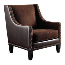 "Uttermost Derek Plush Chestnut Armchair - Coordinated chestnut swirl fabric with saddle brown surround, double row nail head detail, and rich walnut wooden legs. Coordinating fabrics of plush chestnut with swirl sculpting and saddle brown faux leather complete the charm of this compact profile club chair. Features double row, antique brass nail head detail, rich walnut stained legs and removable seat cushion. Light assembly. Seat height is 16""."