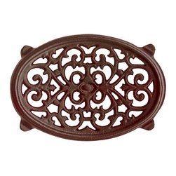 John Wright - Small Oval Filigree Trivet, Brown Majolica - Designed to match our small majolica Steamers, these trivets are porcelain-coated to resist rusting and chipping. The Majolica technique has a long, rich history in ceramics. By the time of the Italian Renaissance, Majolica had reached the height of technical perfection, and was exported all over the world, usually via the isle of Majorca, thus the name Majolica. It produces a deep, rich color with a high gloss. Used under Steamers, they protect your woodstove from scratches and also slow down the heating process (so you don't have to fill the steamers as frequently!). But there are many other creative uses - in the kitchen under hot pans, under a potted plant, or as the base of a table centerpiece.