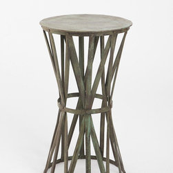 Iron Strap Side Table - So this may not technically be an outdoor table but I think it should be. I love the industrial flair of the steel straps wound into a table support. Very clever design