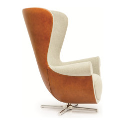 La Viola Decor - Martin Tall Back Leather Armchair - Brilliantly and intelligently designed in an abstract shape and style, this Martin tall back armchair appeals to modern tastes without denying style and comfort. This armchair is expertly built around sturdy wooden frame that is shaped and designed around the needs and demands of your body to make your sitting experience comfortable. The back and arm rests perfectly hug and hold the body to help you relax into your armchair. All the while, this armchair doesn't lose its style or modern appeal. Abstractly shaped to add uniqueness and style to your home or office, this armchair doesn't only feel great; it also looks great, too.