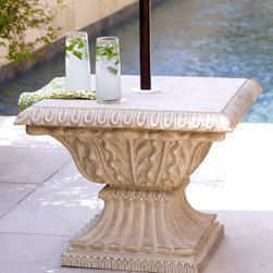 Horchow - Limestone Umbrella Base - This stand is just the thing to keep your umbrella upright and and your drinks in the shade, all while making a regal statement indeed. Handcrafted of crushed stone/resin/styrene/fiberglass with a lacquer finish, it holds 27 pounds of sand or dirt for w...