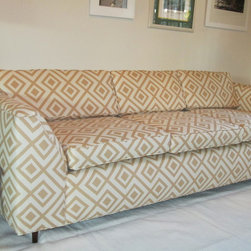 david hicks la fiorentina sofa - Classic, low-profile mid century sofa that has been updated with David Hick's La Fiorentina fabric in the tan/cream colorway. Sleek, yet comfy at the same time. It has asymmetrical arms, a sloped back and tapered legs.