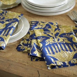 Hanukkah Metallic Napkins - These striking napkins in sapphire blue hues with golden accents are a lovely addition to a Hanukkah dinner table setting.
