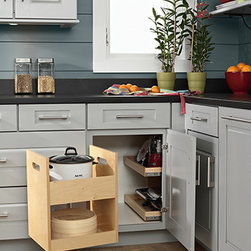 Blind Corner Storage - Your corner space works overtime with this all wood construction blind corner storage cabinet. Two roll out trays with swing-out pantry put stored items at your fingertips.