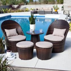 Coral Coast Layton All-Weather Wicker Balcony Chat Set - When most other modern objects require you to come to them the Coral Coast Layton All-Weather Wicker Balcony Chat Set does everything it can to bring modern style to your space and situation. Under the shifting tones of the brown resin wicker is a frame of rust-proof aluminum that can withstand climates from Reykjavik to Rio. Resin wicker looks and feels just like traditional wicker but has the resistance to rot wear and moisture that comes from its resin construction. Each chair and ottoman includes a foam-filled cushion covered with outdoor all-weather canvas fabric in neutral beige. The companion end table sports a glass top creating the perfect spot to land when enjoying a coffee in the morning or a beer at night or just spending the middle of the day relaxing. Each chair weighs 20 lbs the ottomans weigh 6 lbs and the end table weighs 8 lbs. No assembly is required. Chair Dimensions: 28.5W x 31D x 36H inches End Table Dimensions: 23 diam. x 21H inches Ottoman Dimensions: 18.5 diam. x 14.5H inches About Coral CoastWhat if when you closed your eyes you pictured yourself in your own backyard? Coral Coast has a collection of easygoing affordable outdoor accessories for your patio pool or backyard. The latest colors and styles mingle with true classics in weather-worthy fabrics and finished woods ready for relaxation. Make yours a life of leisure.