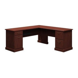 Bush Syndicate 72-in. L-Desk - Harvest Cherry - Work days can be unpredictable, but the Bush Syndicate 72-in. L-Desk - Harvest Cherry is flexible enough to handle anything that comes across it. Crafted with durable laminate finished in a rich, warm harvest cherry shade, this executive desk boasts easy-access open shelving below the corner-design desktop, keeping keyboards and file folders within reach. Two file units each are outfitted with two spacious, full-extension drawers on ball-bearing suspensions. An integrated four-port USB hub, built-in charging station, and wire-management system keep computers, laptops, fax machines, and mobile phones fired up - and keep you one step ahead of every unexpected turn.About Bush FurnitureBush Furniture is the eighth largest furniture company in the United States. Bush manufactures high-quality products, which are designed to be easily assembled and provide great value for the price. Bush furniture is made from a combination of particleboard, fiberboard, and solid wood components. The use of real wood components will be noted in the product description, if applicable.Bush Industries has over 4,000,000 total square feet of manufacturing, warehousing, and distribution space. This allows for a very wide selection of high-quality furniture with the ability to ship quickly. All standard residential Bush products carry a generous 6-year warranty. All Bush business furniture, including the A series, C series, and Quantum series, is backed by a 10-year warranty from Bush, one of the best in the industry.Please note this product does not ship to Pennsylvania.