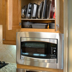 Tray Dividers - Store your baking trays, muffin tins, cutting boards and more in a tray bin installed above your oven for easy access.  Leave space for a bottom shelf for additional storage if desired, as shown in this picture.
