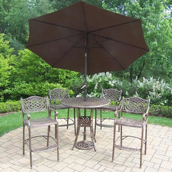 Oakland Living - 7-Pc Cast Aluminum Patio Bar Set - Includes a bar table, four bar stools, 108 in. tilt crank umbrella with stand and metal hardware. Traditional lattice pattern and scroll work. Handcasted and lightweight. Durable and rust free. Fade, chip and crack resistant. Hardened powder coat. Warranty: One year. Antique bronze finish. Minimal assembly required. Table: 42 in. Dia. x 44 in. H (60 lbs.). Bar stool: 21.5 in. W x 22 in. D x 46 in. H (47 lbs.)The Oakland Mississippi Collection combines grace style and modern designs giving you a rich addition to any outdoor setting. The pattern is crisp and stylish. Each piece is finished for the highest quality possible. This set will be a beautiful addition to your patio, balcony or outdoor entertainment area. Our bar sets are perfect for any small space, or to accent a larger space. We recommend that the products be covered to protect them when not in use. To preserve the beauty and finish of the metal products, we recommend applying an epoxy clear coat once a year. However, because of the nature of iron it will eventually rust when exposed to the elements.